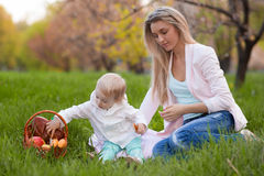Mother and daughter having picnic Stock Photos