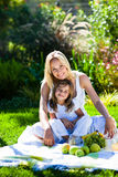 Mother and daughter having a picnic Royalty Free Stock Image