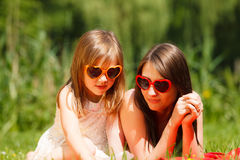 Mother and daughter having picnic in park royalty free stock image