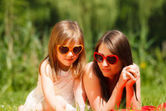 Mother and daughter having picnic in park Stock Photo