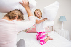 Mother and daughter having pillow fight Royalty Free Stock Photo