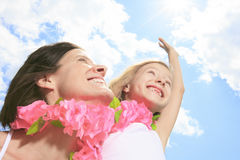 Mother with is daughter having a pink necklace Stock Image