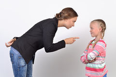 Mother and daughter having quarrel. Anger mother and small daughter having quarrel royalty free stock photography