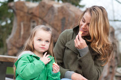Mother and daughter having a snack outside Stock Photography