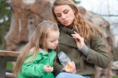 Mother and daughter having a snack outside Royalty Free Stock Image