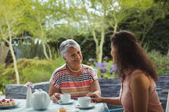 Mother and daughter having tea Stock Photo
