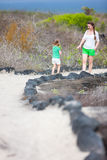 Mother and daughter hiking at Galapagos islands Stock Images