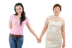 Mother and daughter hold hands Stock Images