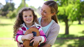 A mother and daughter holding a ball Stock Images