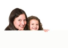 Mother and daughter holding a card Stock Photo