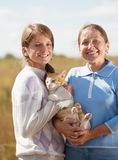 Mother with  daughter is holding cat Royalty Free Stock Image