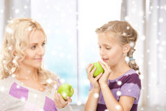 Mother and daughter holding green apples Stock Photography