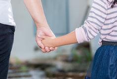 Mother and daughter holding hand in hand. Care and love concept royalty free stock photos