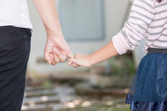 Mother and daughter holding hand in hand. Care and love concept stock photos