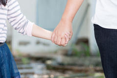 Mother and daughter holding hand in hand. Care and love concept royalty free stock image