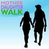 Mother Daughter Holding Hands. An image of mother and daughter holding hands while walking Stock Image