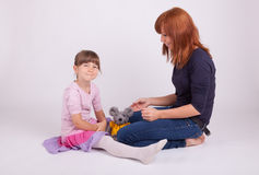 Mother and daughter are holding hands Stock Photography
