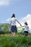 Mother and daughter - holding hands Stock Images