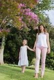 Mother and daughter holding hands Stock Image