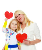 Mother and daughter holding a heart. Royalty Free Stock Image