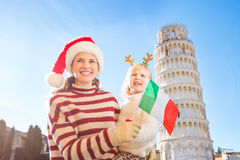 Mother and daughter holding Italian flag. Christmas in Pisa Stock Image