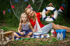 Mother and daughter holding lifebuoy Stock Photo