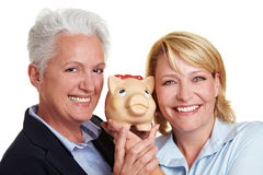 Mother and daughter holding piggy Royalty Free Stock Photos
