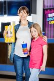 Mother And Daughter Holding Popcorn And Drink In Royalty Free Stock Images