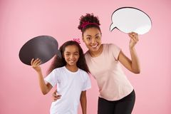 Mother and daughter are holding speech bubbles. royalty free stock photos
