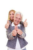 Mother and daughter holding thumbs Stock Image