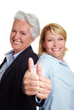 Mother and daughter holding thumbs Stock Photography