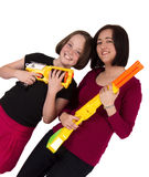 Mother and daughter holding toy guns. Portrait of a mother and daughter holding toy guns Stock Photos