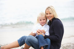 Mother And Daughter On Holiday Sitting On Beach Royalty Free Stock Image
