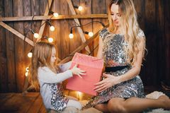 Mother and daughter in the holiday spirit stock photography