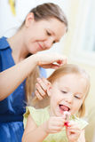 Mother and daughter at home Royalty Free Stock Photos