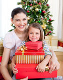 Mother and daughter at home at Christmas time Stock Photography