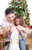 Mother and daughter at home at Christmas time Stock Photo