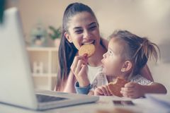 Mother and daughter at home. stock photo