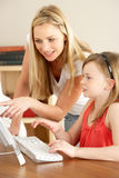 Mother And Daughter At Home Using Computer Royalty Free Stock Images