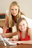 Mother And Daughter At Home Using Computer Royalty Free Stock Photo