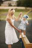 Mother with daughter playground Stock Photos