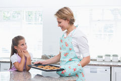 Mother and daughter with hot fresh cookies Royalty Free Stock Images