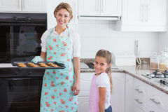 Mother and daughter with hot fresh cookies Royalty Free Stock Image