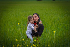 Mother and daughter. Hug in the weath field stock photography