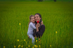 Mother and daughter. Hug in the weath field stock image
