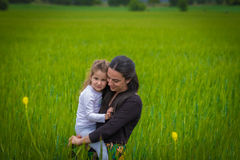Mother and daughter. Hug in the weath field royalty free stock photos