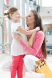 Mother and daughter hugging Stock Photography