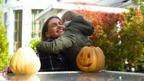 Mother and daughter hugging on backyard, happy childhood, celebrating Halloween stock image