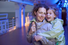 Mother daughter hugging on deck of ship Royalty Free Stock Photos