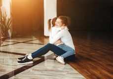 Mother and daughter hugging in the gym Stock Images